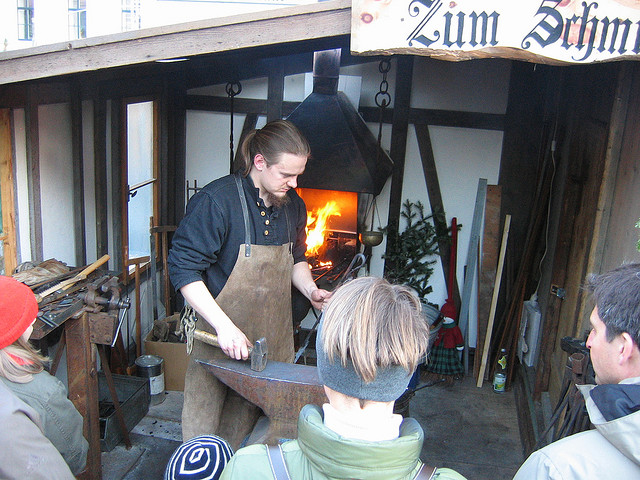 german christmas munich medieval market entertainment blacksmith craftsmen