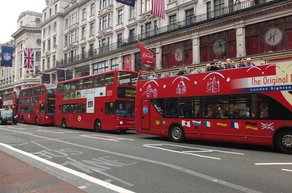 London buses lined up three in a row head to tail