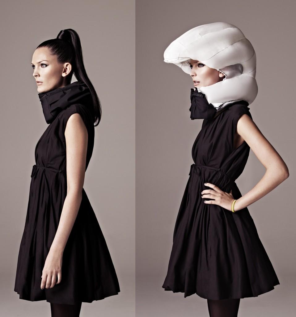hoding helmet in cocktai dress