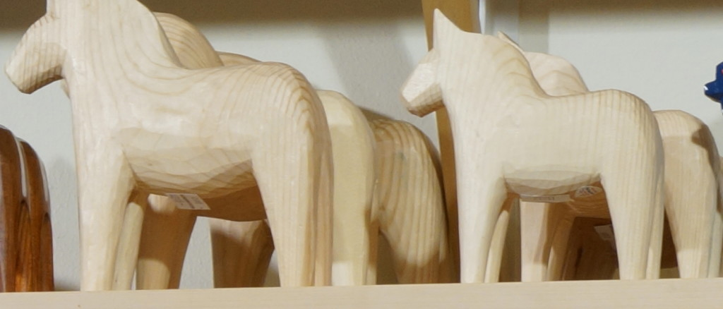 carved Dala horse unpainted Sweden