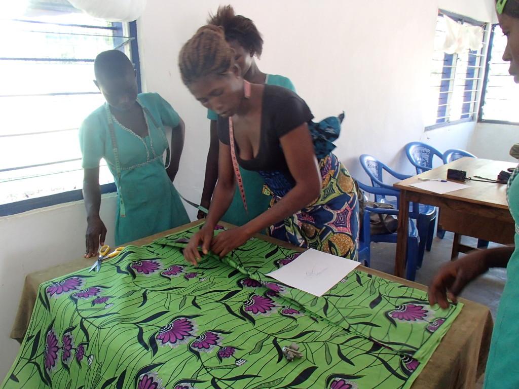 ghana africa seamstress at work fabric
