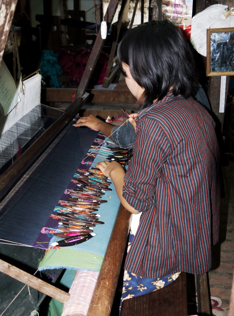 In Amarapura, the Burmese use traditional methods to weave silk and cotton textiles.