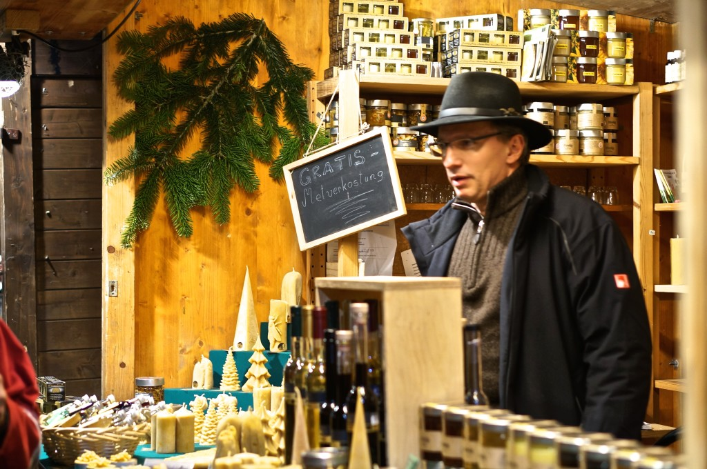 59863a72ce9 Vienna Austria Spittelberg Christmas Market vendor alpine hat stall beeswax  candles